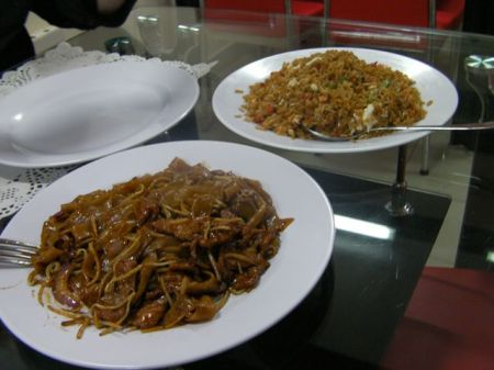 plates of beef noodles and fried rice