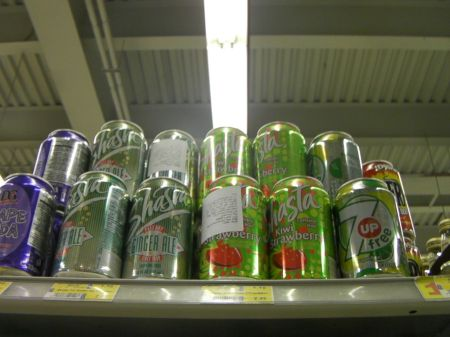 cans on top grocery shelf