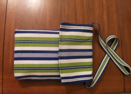 blue/green/white striped carry bag