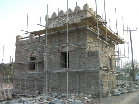 stone building covered in scaffolding