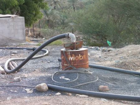 old rusted Mobil oil barrel that is now part of a water well