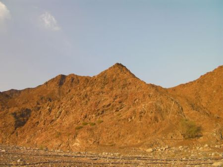 red mountains in the late afternoon sun