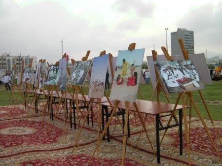 easels containing pictures of cultural activities