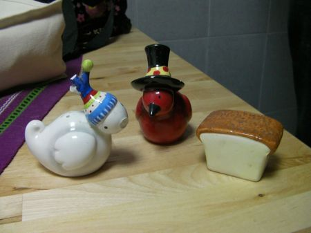 salt and pepper shakers shaped like birds and a salt shaker shaped like a slice of bread