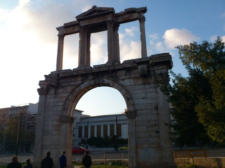 large stone arch with a Roman colonnade on top