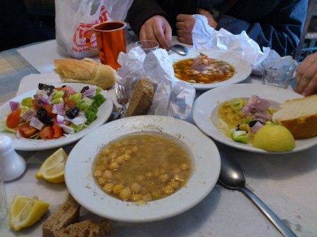 four bowls of food, salad, chickpeas, large bean soup, fava bean paste