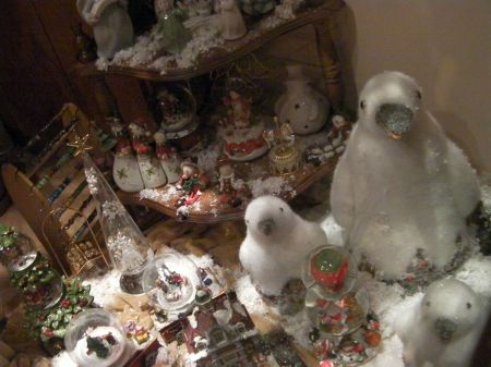 store window display with white penguins