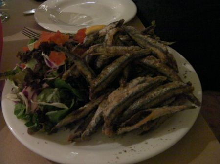 tiny fried fish and green salad