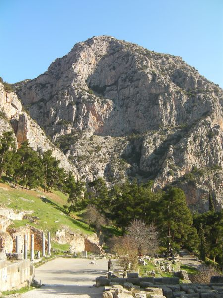 Greek ruins with an imposing mountain behind