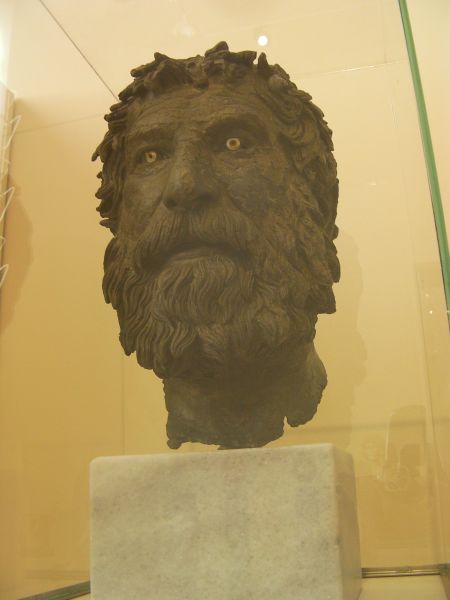 bronze sculpture of a bearded man's head
