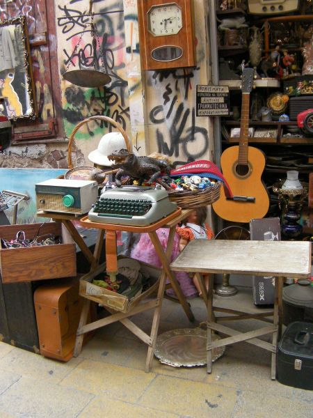 store offering a stuffed aligator, guitar, typewriter, and a variety of other odds and ends
