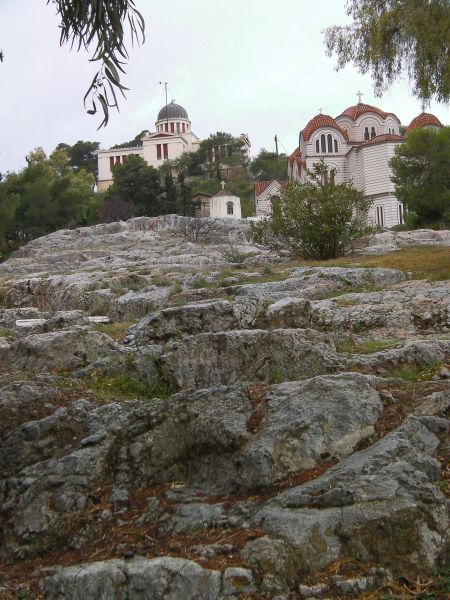 hillside ancient ruins, churches in background