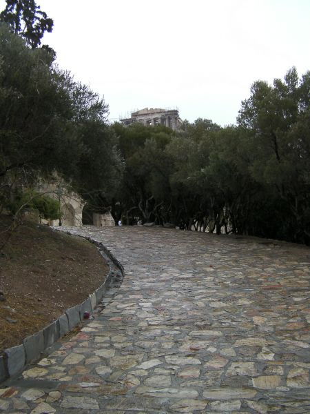 stone walkway uphill with Parthenon in the distance