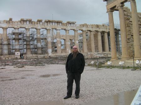 my husband standing in front of the Parthenon