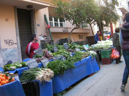 street lined with tables full of vegetables for sale