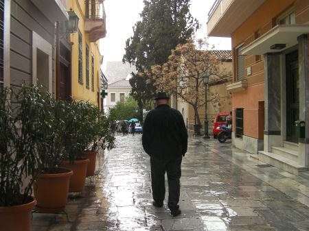 man walking down a marble paved street