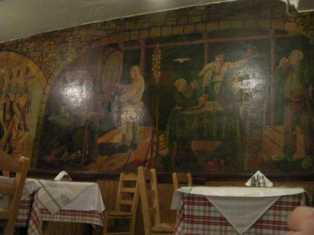 restaurant with murals on the wall
