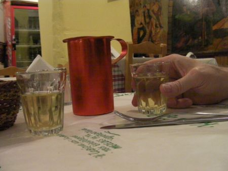 a one half kilo carafe of retsina wine and two shot glasses