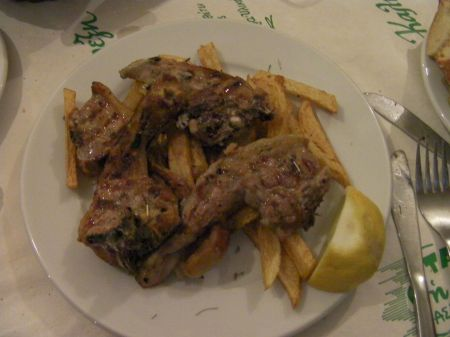 lamb chops on a bed of fries