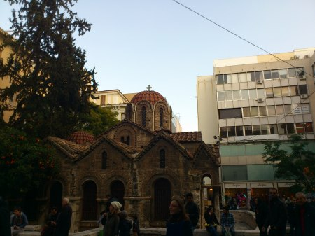ancient church nestled among newer buildings