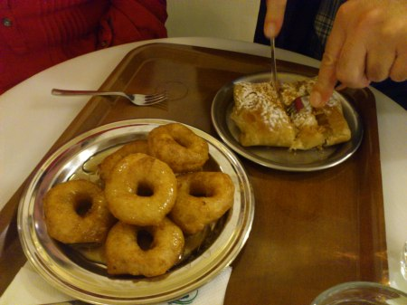 six donuts on a plate, one rectangular pastry on a plate