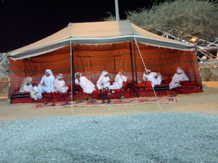 men resting in a tent