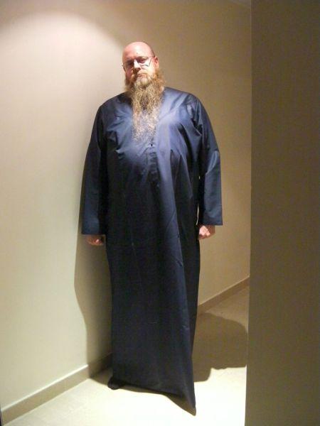 man in a blue kandora