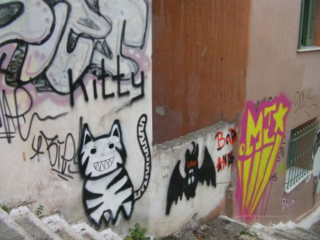 graffiti depicting a black and white cat