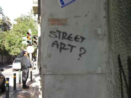 "graffiti that asks ""street art?"""