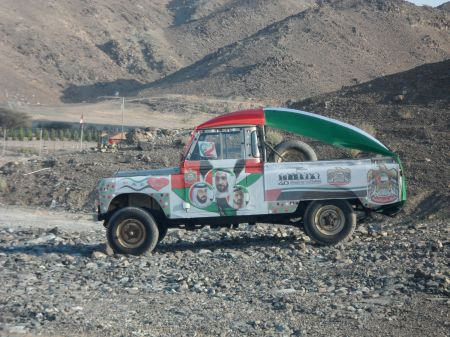 truck decorated with pictures and flag colors