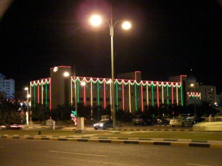 building draped in red, green and white lights