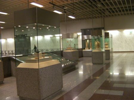 glass cases containing artifacts and pottery