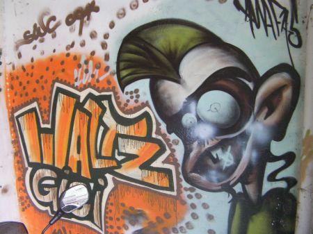 graffiti that states waltz gigi with a face with a mohawk hairdo