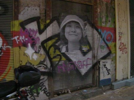graffiti incorporating a photograph of a girl in a hat