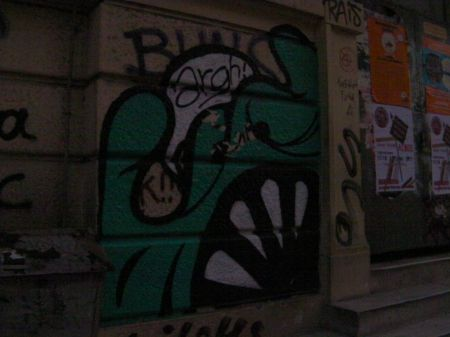 graffiti of a green monster saying argh