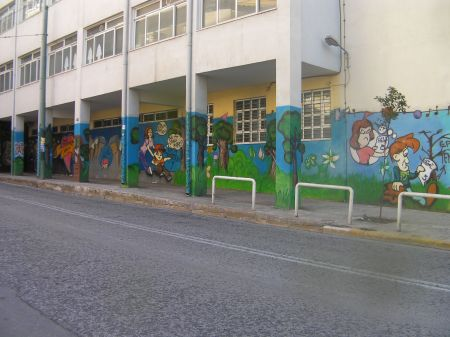 school covered in decorative graffiti