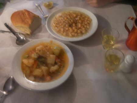 a bowl of vegetable stew and a bowl of chick peas