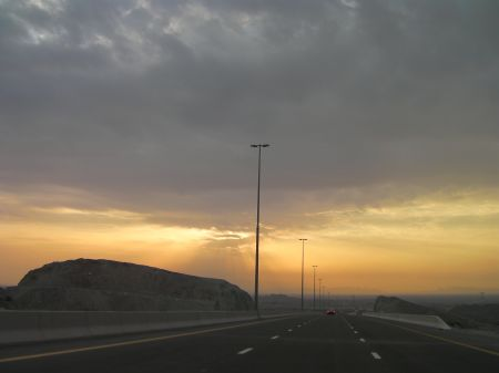 sun shining through clouds on the new Fujairah highway