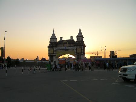 sun setting behind the entrance gate
