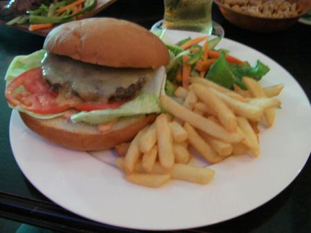 hamburger with a giant bun, fries and a salad
