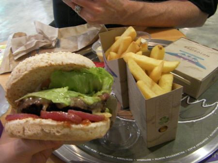 burger with lots of toppings and large fries