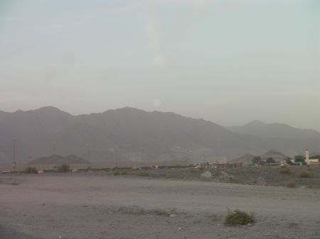 the Moon just above the hills of Fujairah about to disappear