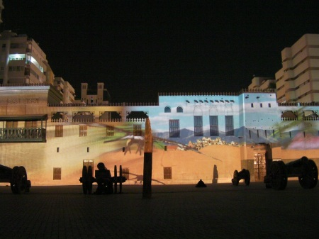 desert scene projected on the side of the fort