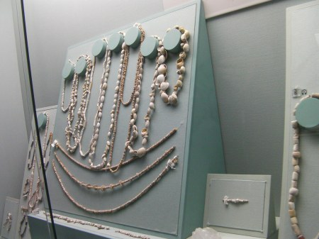 showcase displaying ancient shell jewellery