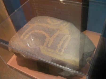 petroglyph of a bull under a crescent moon