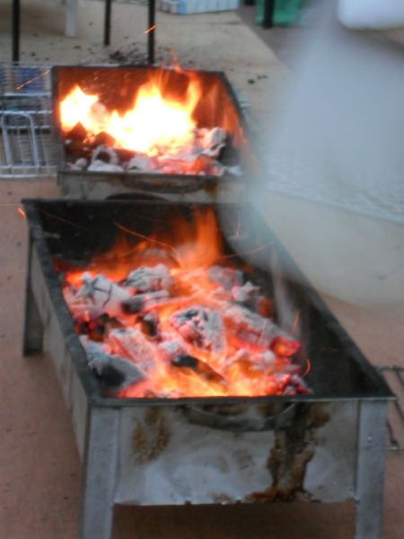 small rectangular metal containers with burning coals