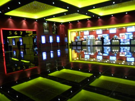 large, colorfully lit cinema lobby area