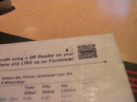 qr code in the corner of a restaurant menu