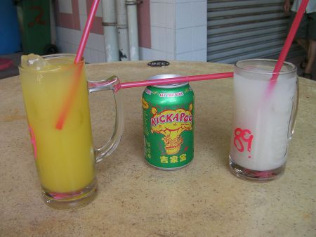mug of lime juice, can of Kickapoo Joy Juice, and a mug of barley water