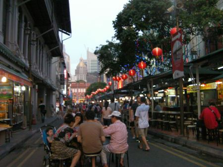 food road in Singapore Chinatown lined with restaurants and food booths